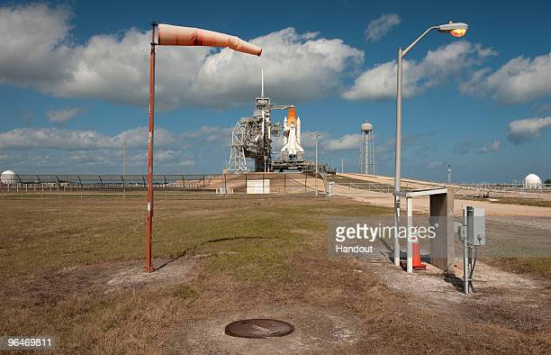 In this handout image provided by NASA The space shuttle Endeavour is seen as strong winds inflate a windsock at NASA's Kennedy Space Center February...