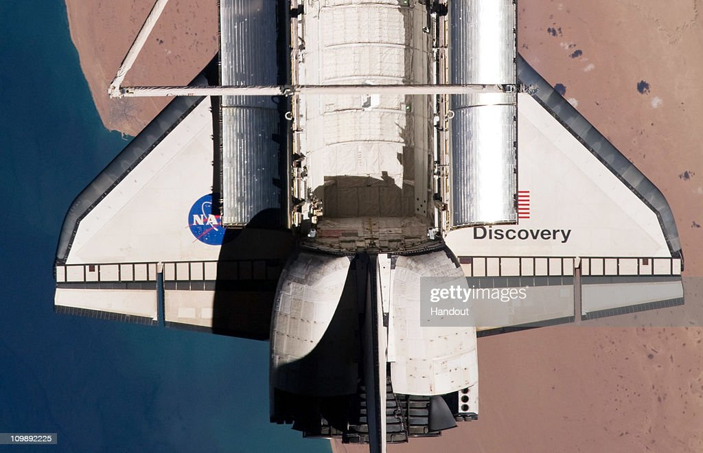 In this handout image provided by NASA, the the tail section of space shuttle Discovery is seen from the International Space Station as the two orbital spacecraft accomplish their relative separation after an aggregate of 12 astronauts and cosmonauts worked together for over a week during flight day 12 activities March 7, 2011 in Space. Discovery, on its 39th and final flight, is carrying the Italian-built Permanent Multipurpose Module (PMM), Express Logistics Carrier 4 (ELC4) and Robonaut 2, the first humanoid robot in space to the International Space Station. Discovery was in service for 27 years and will be decommissioned and sent to a museum. Two remaining shuttle missions are planned before the program ends.