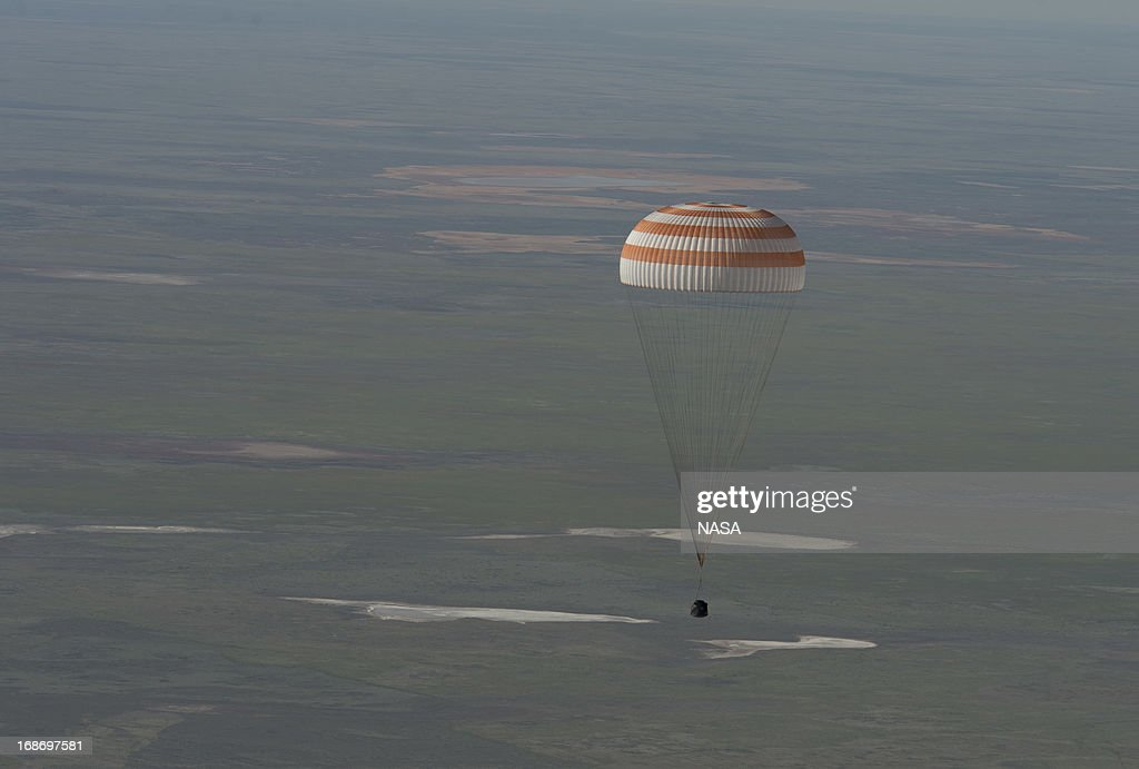 In this handout image provided by NASA,The Soyuz TMA-07M spacecraft lands with Expedition 35 Commander Chris Hadfield of the Canadian Space Agency (CSA), NASA Flight Engineer Tom Marshburn and Russian Flight Engineer Roman Romanenko of the Russian Federal Space Agency (Roscosmos) on May 14, 2013 in a remote area near the town of Dzhezkazgan, Kazakhstan. Hadfield, Marshburn and Romanenko returned from five months onboard the International Space Station where they served as members of the Expedition 34 and 35 crews.