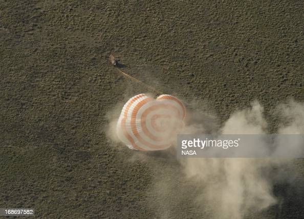 In this handout image provided by NASAThe Soyuz TMA07M spacecraft lands with Expedition 35 Commander Chris Hadfield of the Canadian Space Agency NASA...