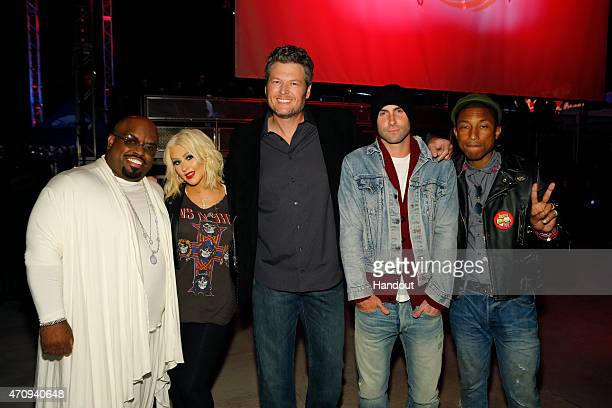In this handout image provided by NBCUniversal former coach on 'The Voice' CeeLo Green poses with current coaches of 'The Voice' Christina Aguilera...