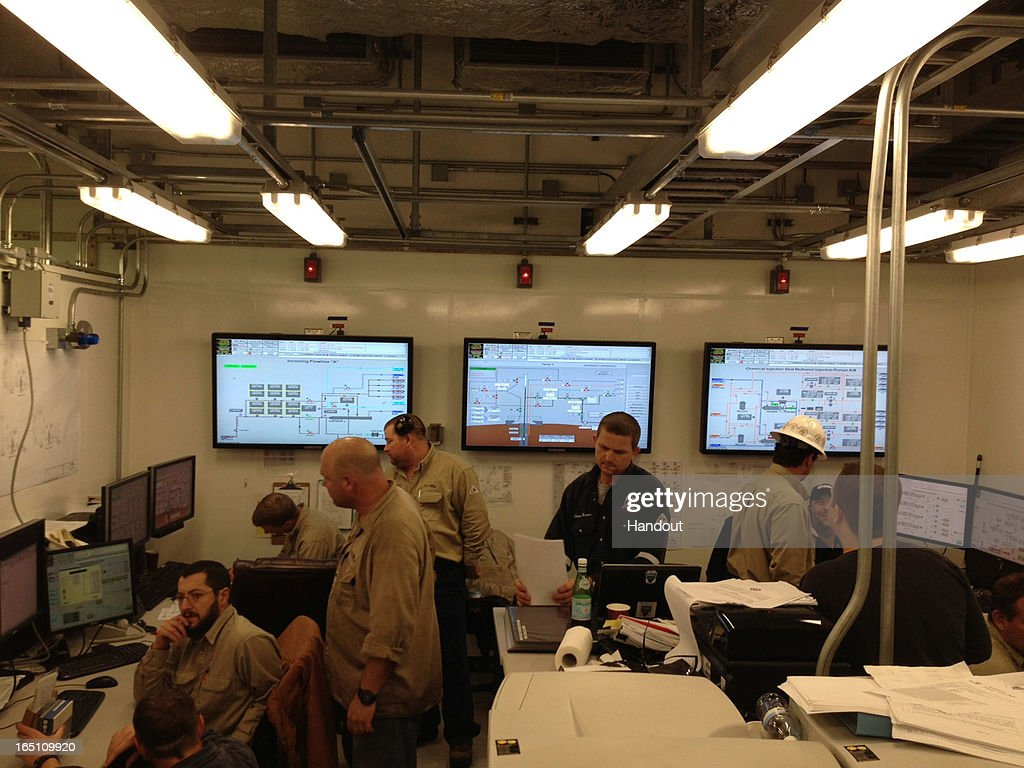 In this handout image provided by Nobel Energy, Nobel Energy personnel are seen in the control room of the Tamar drilling natural gas production platform some 25 kilometers West of the Ashkelon shore on March 30, 2013 in Israel. The offshore Tamar drilling site which was originally dispatched from a shipyard in Texas at the end of last year is due to start producing natural gas next week. Over the past few years Israel has suffered from a shortage in natural gas, but with the new platform that weighs 34,000 tons and will be mainly operated by Israelis, the US company Nobel Energy which owns a 36% stake in Tamar, hopes to change Israel's energy situation as well as the economy as a whole.
