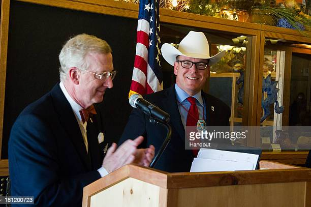 In this handout image provided by Palais Princier HSH Prince Albert II of Monaco receives a new Stetson hat from Buffalo Bill Center of the West...
