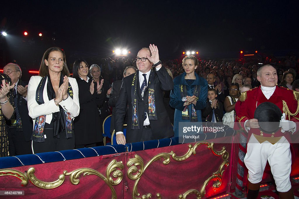 In this handout image provided by Palais Princier, (L-R) Princess Stephanie of Monaco, Prince Albert II of Monaco and Princess Charlene of Monaco attend the 38th International Circus Festival on January 21, 2014 in Monte-Carlo, Monaco.