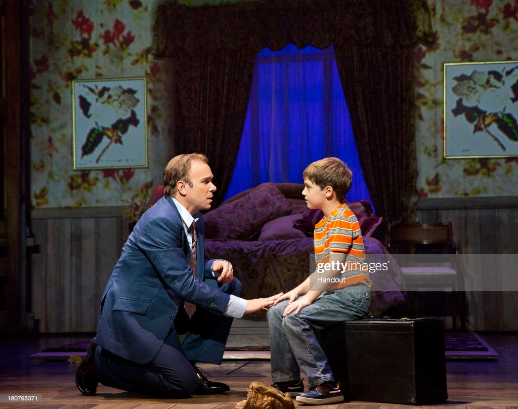 In this handout image provided by Paul Kolnik/The Hartman Group, Norbert Leo Butz as Edward Bloom and Zachary Unger as Young Will are seen in a production photo of 'Big Fish' directed by five-time Tony Award winner Susan Stroman. 'Big Fish' began performances September 5, 2013 and opens October 6, 2013 at the Neil Simon Theatre. The production stars Norbert Leo Butz as Edward Bloom, Kate Baldwin as Sandra Bloom, Bobby Steggert as Will Bloom, Krystal Joy Brown as Josephine Bloom, Anthony Pierini and Zachary Unger alternating as Young Will, Ryan Andes as Karl, Ben Crawford as Don Price, and Brad Oscar as Amos Calloway. Additional cast includes JC Montgomery, Ciara Renee, Kirsten Scott, and Sarrah Strimel.