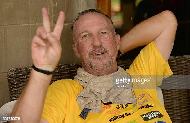 In this handout image provided by Philip Brown Sir Ian Botham rests after completing the 'Beefy Walking the Rainbow Nation' charity walks on December...