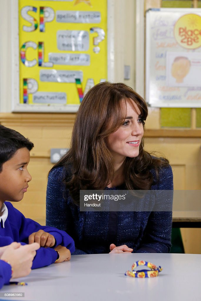 In this handout image provided by Place2Be, Catherine, Duchess of Cambridge with Ryan, 10, from Salusbury Primary School in Queen's Park, London, during filming of a video message for Children's Mental Health week. Catherine is the royal patron of the children's mental health charity Place2Be and in her message she highlights the importance of giving youngsters the 'tools to cope, and to thrive' as they encounter life's challenges.