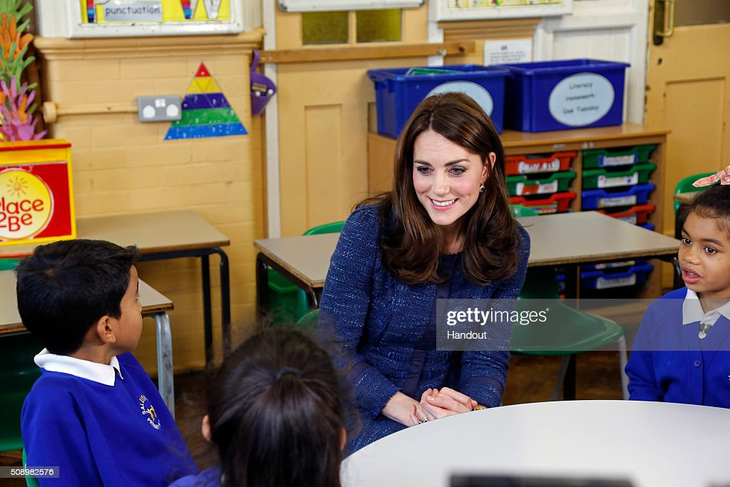 In this handout image provided by Place2Be, Catherine, Duchess of Cambridge with (L-R) Ryan, 10, and Bailey-Rae ,7, from Salusbury Primary School in Queen's Park, London, during filming of a video message for Children's Mental Health week. Catherine is the royal patron of the children's mental health charity Place2Be and in her message she highlights the importance of giving youngsters the 'tools to cope, and to thrive' as they encounter life's challenges.