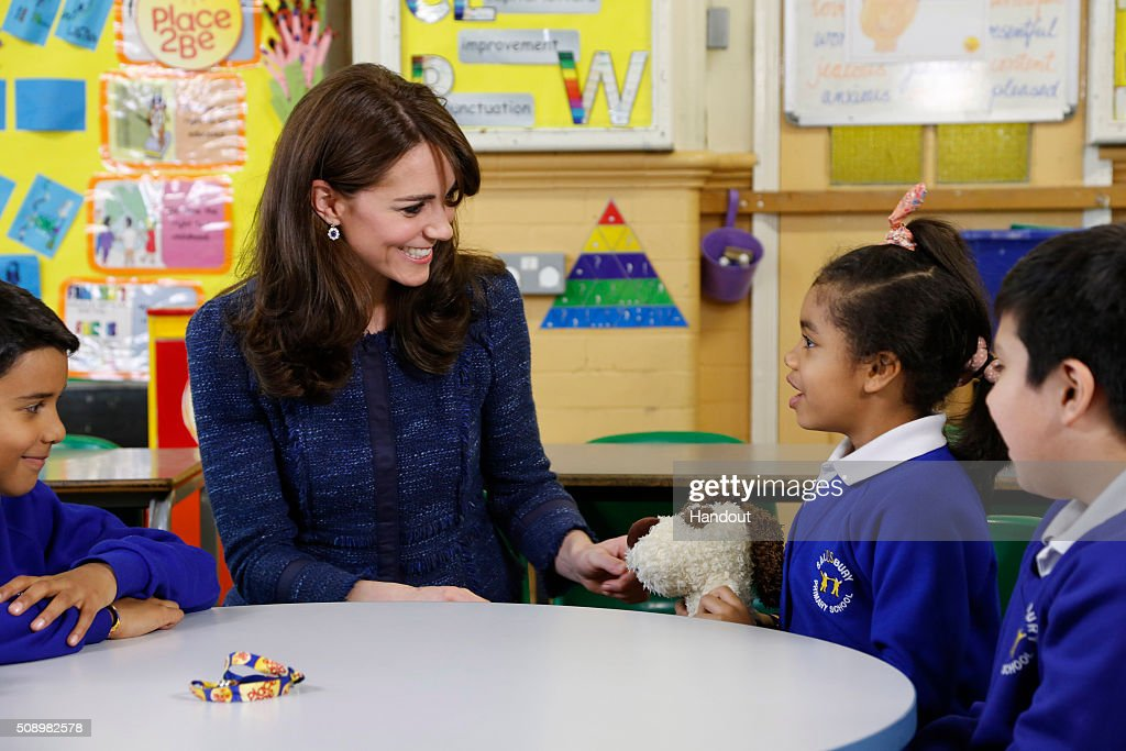 In this handout image provided by Place2Be, Catherine, Duchess of Cambridge with (L-R) Ryan, 10, Bailey-Rae ,7, and Connor, 11, from Salusbury Primary School in Queen's Park, London, during filming of a video message for Children's Mental Health week. Catherine is the royal patron of the children's mental health charity Place2Be and in her message she highlights the importance of giving youngsters the 'tools to cope, and to thrive' as they encounter life's challenges.