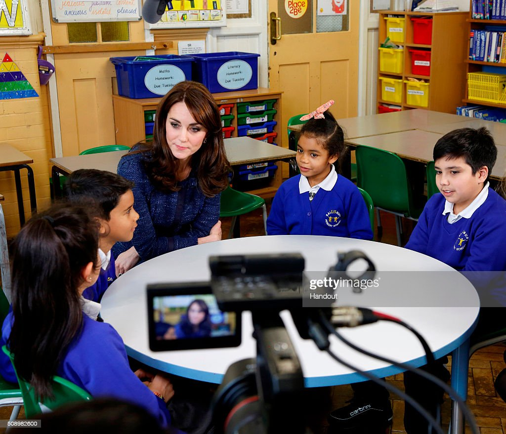 In this handout image provided by Place2Be, Catherine, Duchess of Cambridge with (L-R) Nimra, 10, Ryan, 10, Bailey-Rae ,7, and Connor, 11, from Salusbury Primary School in Queen's Park, London, during filming of a video message for Children's Mental Health week. Catherine is the royal patron of the children's mental health charity Place2Be and in her message she highlights the importance of giving youngsters the 'tools to cope, and to thrive' as they encounter life's challenges.