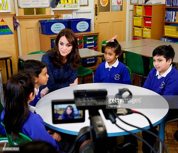In this handout image provided by Place2Be Catherine Duchess of Cambridge with Nimra Ryan BaileyRae and Connor from Salusbury Primary School in...