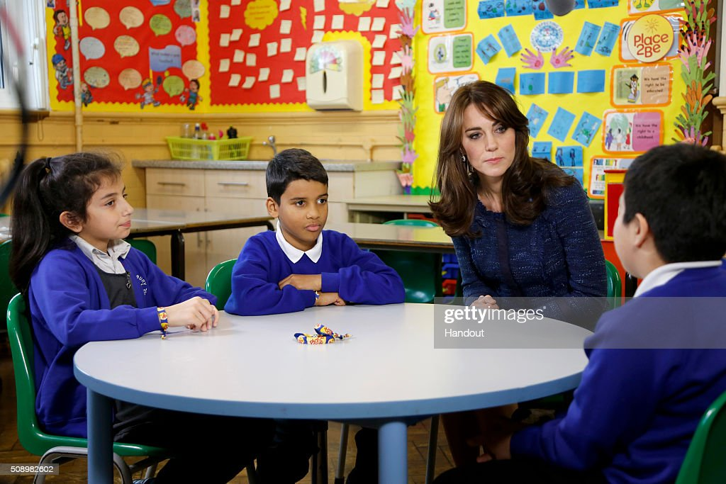 In this handout image provided by Place2Be, Catherine, Duchess of Cambridge with (L-R) Nimra, 10, Ryan, 10, and Connor, 11, from Salusbury Primary School in Queen's Park, London, during filming of a video message for Children's Mental Health week. Catherine is the royal patron of the children's mental health charity Place2Be and in her message she highlights the importance of giving youngsters the 'tools to cope, and to thrive' as they encounter life's challenges.