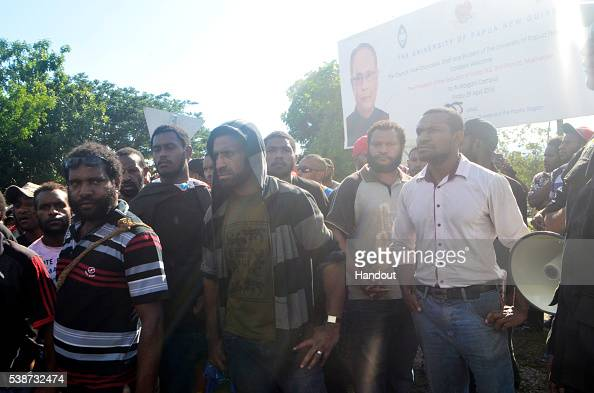 In this handout image provided by PNGFM News protesters and police are seen during an antigovernment protest at the University of Papua New Guinea on...
