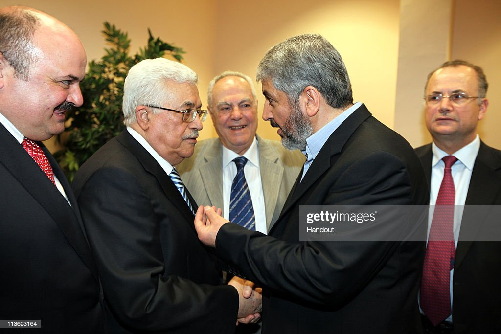 In this handout image provided by PPM, Exiled Leader of Hamas, Khaled Mashaal (2R) meets with President of the Palestinian National Authority, <a gi-track='captionPersonalityLinkClicked' href=/galleries/search?phrase=Mahmoud+Abbas&family=editorial&specificpeople=176534 ng-click='$event.stopPropagation()'>Mahmoud Abbas</a> (2L) on May 4, 2011 in Cairo, Egypt. The rival factions, Fatah and Hamas, signed a reconciliation accord in Cairo after reaching common ground against Israeli occupation and peace efforts. Mashaal said they had a 'common goal; a Palestinian state with full sovereignty on the 1967 borders with Jerusalem as the capital'. Israeli Prime Minister Benjamin Netanyahu claimed that the reconcilation between the factions as a 'blow to peace', but the US declined to make any comment.