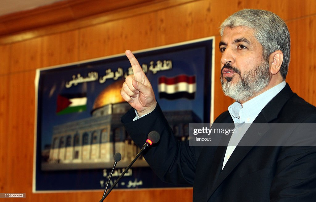 In this handout image provided by PPM, Exiled Leader of Hamas, Khaled Mashaal speaks during a meeting of members of Fatah and Hamas on May 4, 2011 in Cairo, Egypt.. The rival factions, Fatah and Hamas, signed a reconciliation accord in Cairo after reaching common ground against Israeli occupation and peace efforts. Mashaal said they had a 'common goal; a Palestinian state with full sovereignty on the 1967 borders with Jerusalem as the capital'. Israeli Prime Minister Benjamin Netanyahu claimed that the reconcilation between the factions as a 'blow to peace', but the US declined to make any comment.
