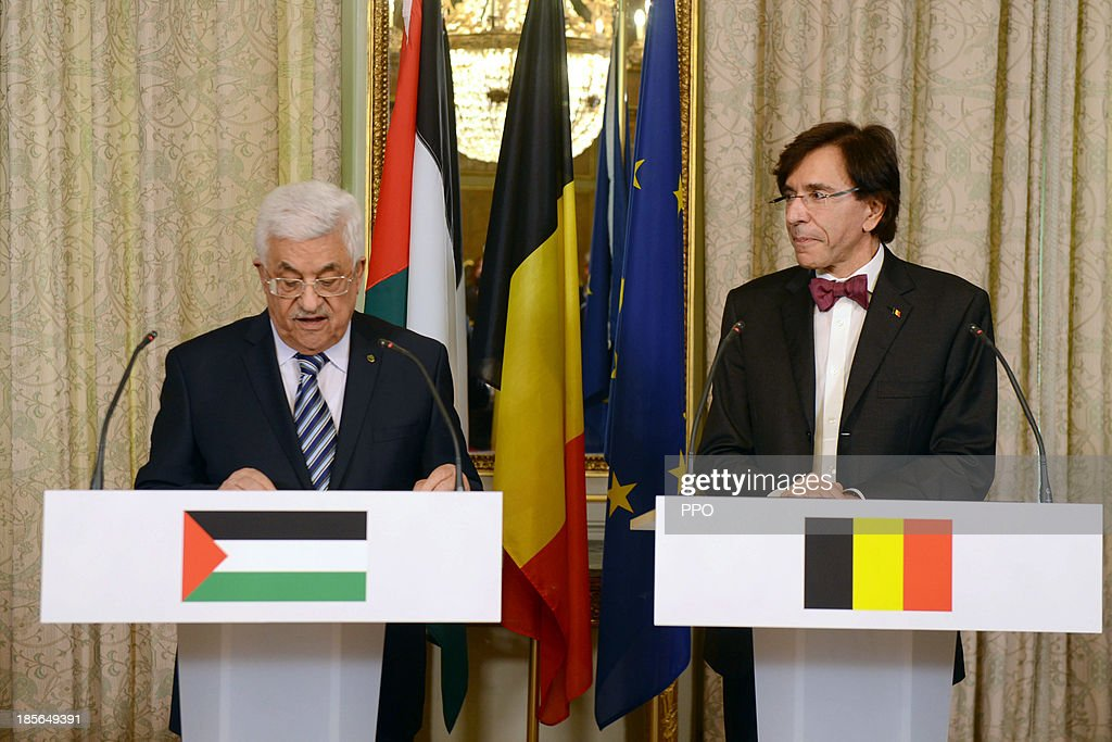 In this handout image provided by PPO, President Mahmoud Abbas (L) meets with Belgian Prime Minister Elio Di Rupo October 23, 2013 in Brussels, Belgium. While in Brussels, Abbas urged foreign companies to boycott businesses based in Israeli settlements.