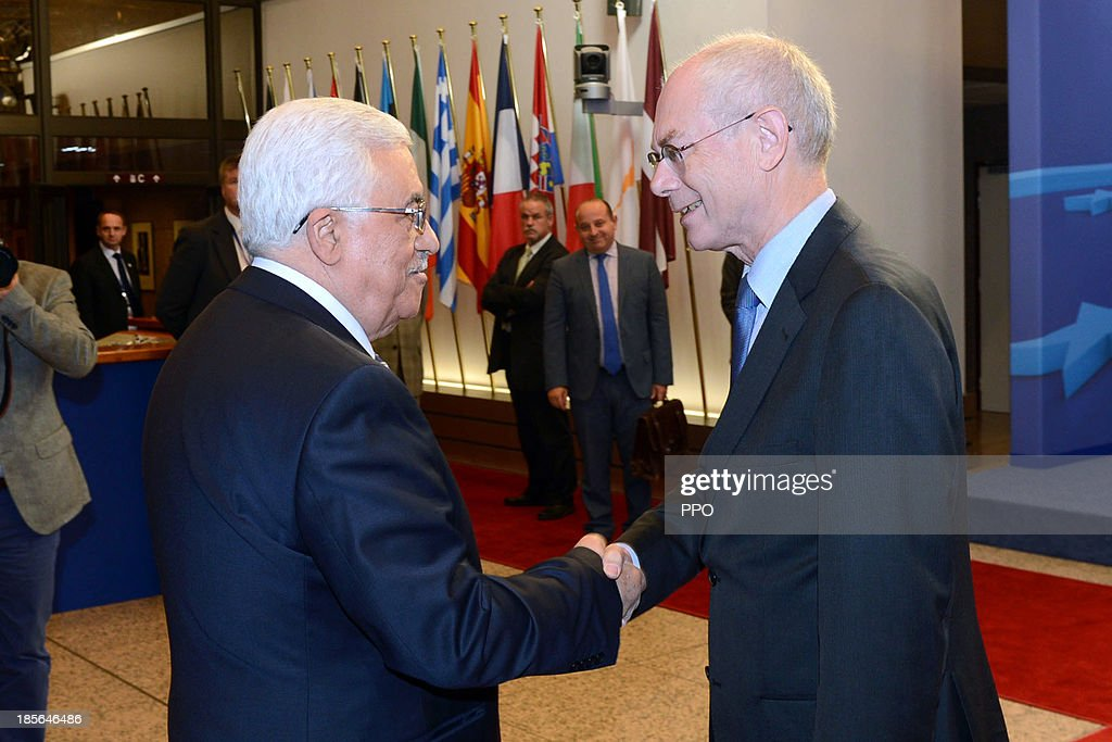 In this handout image provided by PPO, President Mahmoud Abbas (L) shakes hands with European Council President Herman Van Rompuy October 23, 2013 in Brussels, Belgium. While in Brussels, Abbas urged foreign companies to boycott businesses based in Israeli settlements.