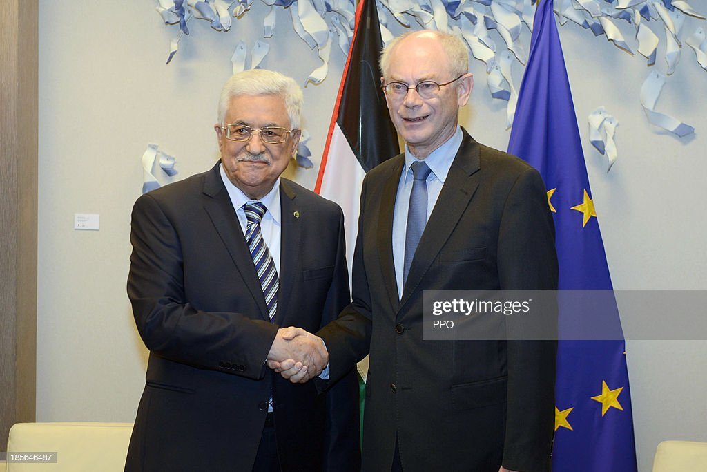 In this handout image provided by PPO, President <a gi-track='captionPersonalityLinkClicked' href=/galleries/search?phrase=Mahmoud+Abbas&family=editorial&specificpeople=176534 ng-click='$event.stopPropagation()'>Mahmoud Abbas</a> (L) shakes hands with European Council President <a gi-track='captionPersonalityLinkClicked' href=/galleries/search?phrase=Herman+Van+Rompuy&family=editorial&specificpeople=4476281 ng-click='$event.stopPropagation()'>Herman Van Rompuy</a> October 23, 2013 in Brussels, Belgium. While in Brussels, Abbas urged foreign companies to boycott businesses based in Israeli settlements.