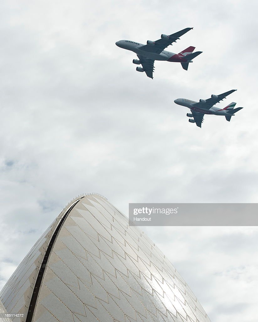 In this handout image provided by Qantas, A Qantas Airbus A380 and Emirates Airbus A380 fly over Sydney Harbour on March 31, 2013 in Sydney, Australia. The two Airbus A380s display is believed to be the first of its kind between two seperate airlines to fly over Sydney's Harbour which will mark the alliance between the two airlines.