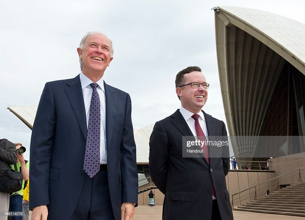In this handout image provided by Qantas, Qantas CEO Alan Joyce (R) and Emirates President Tim Clark watch from the steps of the Sydney Opera House their respective Airbus A380s fly over Sydney Harbour on March 31, 2013 in Sydney, Australia. The two Airbus A380s display is believed to be the first of its kind between two seperate airlines to fly over Sydney's Harbour which will mark the alliance between the two airlines.