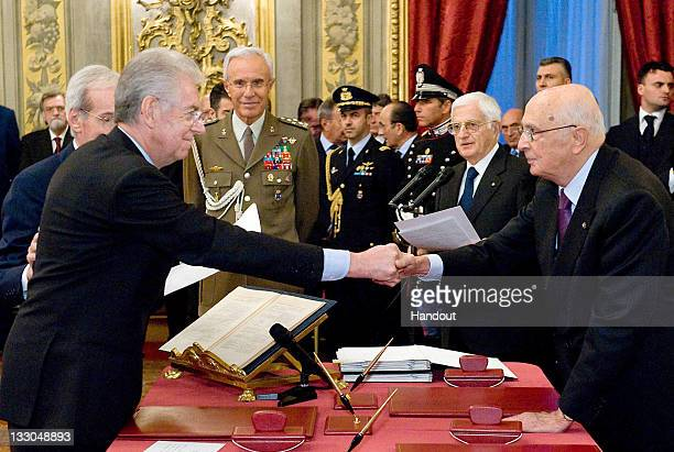 In this handout image provided by Quirinale Press Office President Giorgio Napolitano congratulates prime minister Mario Monti on November 16 2011 in...