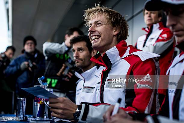 In this handout image provided by Red Bull #1 Porsche 919 LMP1 driver Brendon Hartley of New Zealand signs autographs for fans prior to the 6 Hours...