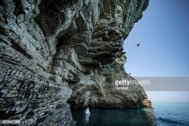 In this handout image provided by Red Bull Alessandro De Rose of Italy dives 23 metres at Grotta dei Pipistrelli on his 'Road to Polignano' trip in...