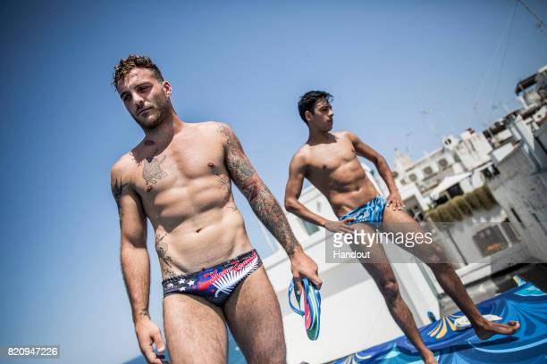 In this handout image provided by Red Bull Alessandro De Rose of Italy and Sergio Guzman of Mexico prepare to dive from the 27 metre platform during...