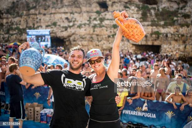 In this handout image provided by Red Bull Alessandro De Rose of Italy and Rhiannan Iffland of Australia celebrate their wins during the third stop...