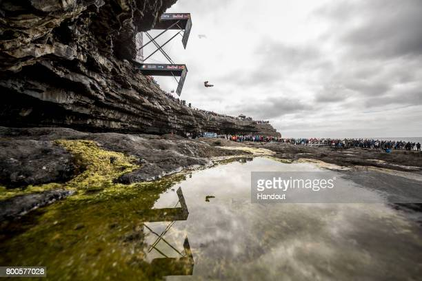 In this handout image provided by Red Bull Alessandro De Rose of Italy dives from the 275 metre platform at the Serpent`s Lair during the first stop...