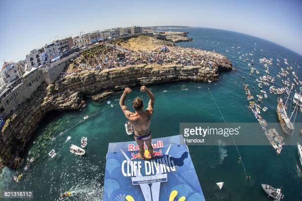 In this handout image provided by Red Bull Alessandro De Rose of Italy acknowledges the spectators before diving from the 27 metre platform during...