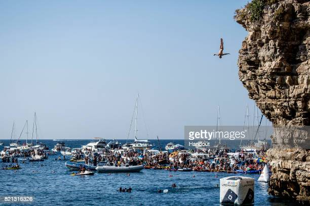 In this handout image provided by Red Bull Alessandro De Rose of Italy dives from the 27 metre platform during the third stop of the Red Bull Cliff...