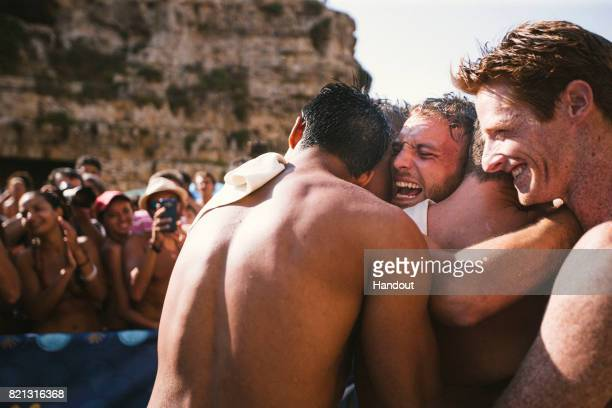 In this handout image provided by Red Bull Alessandro De Rose of Italy celebrates his victory with the others divers during the third stop of the Red...