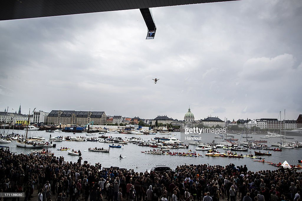 In this handout image provided by Red Bull, Anatoliy Shabotenko of the Ukraine dives from the 28 metre platform at the Copenhagen Opera House during the second stop of the Red Bull Cliff Diving World Series on June 22, 2013 at Copenhagen, Denmark.