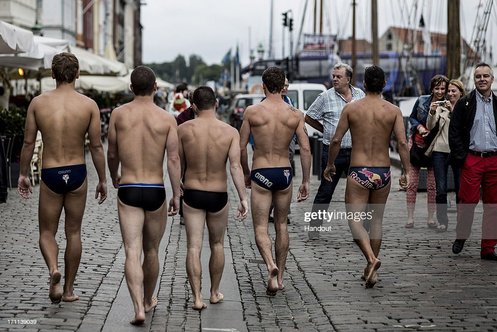 In this handout image provided by Red Bull, (L-R) Anatoliy Shabotenko of the Ukraine, David Colturi and Steven LoBue of the USA, Mat Cowen of the UK and Orlando Duque of Colombia walk on Nyhavn Street on their way to the Copenhagen Opera House prior to the second stop of the Red Bull Cliff Diving World Series on June 22, 2013 at Copenhagen, Denmark.