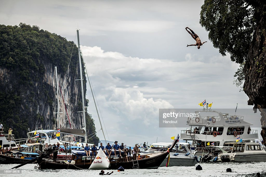 In this handout image provided by Red Bull, Anatoliy Shabotenko of the Ukraine dives from the 27 metre platform on Hong Island in the Andaman Sea during the last competition day of the eighth and final stop of the 2013 Red Bull Cliff Diving World Series on October 26, 2013 at Krabi, Thailand.