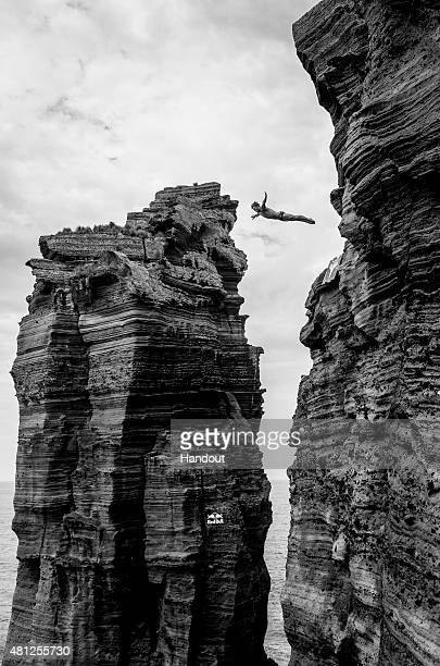 In this handout image provided by Red Bull Anatoliy Shabotenko of the Ukraine dives from the 27 metre cliff face during the fifth stop of the Red...