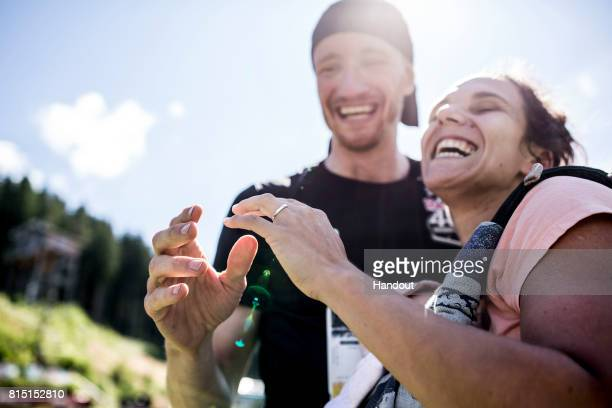 In this handout image provided by Red Bull Andi Meier of Switzerland proposes to his wifetobe Gosia at Hochfirstschanze during the Red Bull 400 World...