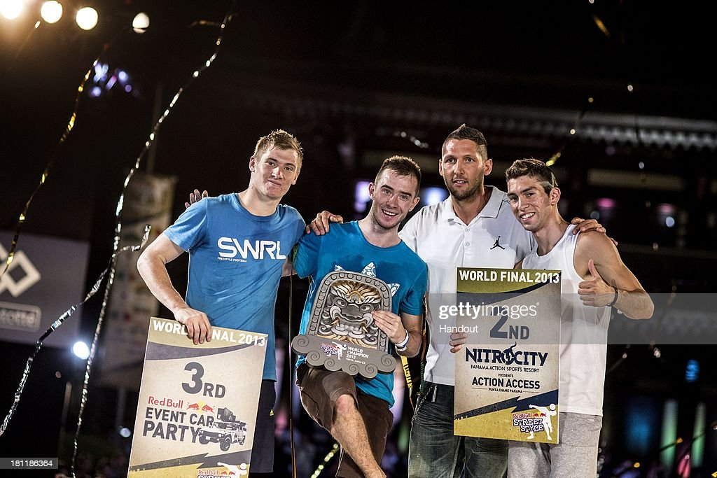 In this handout image provided by Red Bull, (L-R) Andrew Henderson of the UK, Szymon Skalski of Poland, Marco Materazzi of Italy, and Carlos Iacono from Argentina celebrate at Zojoji Temple during the Red Bull Street Style freestyle football world finals on September 19, 2013 at Tokyo, Japan.