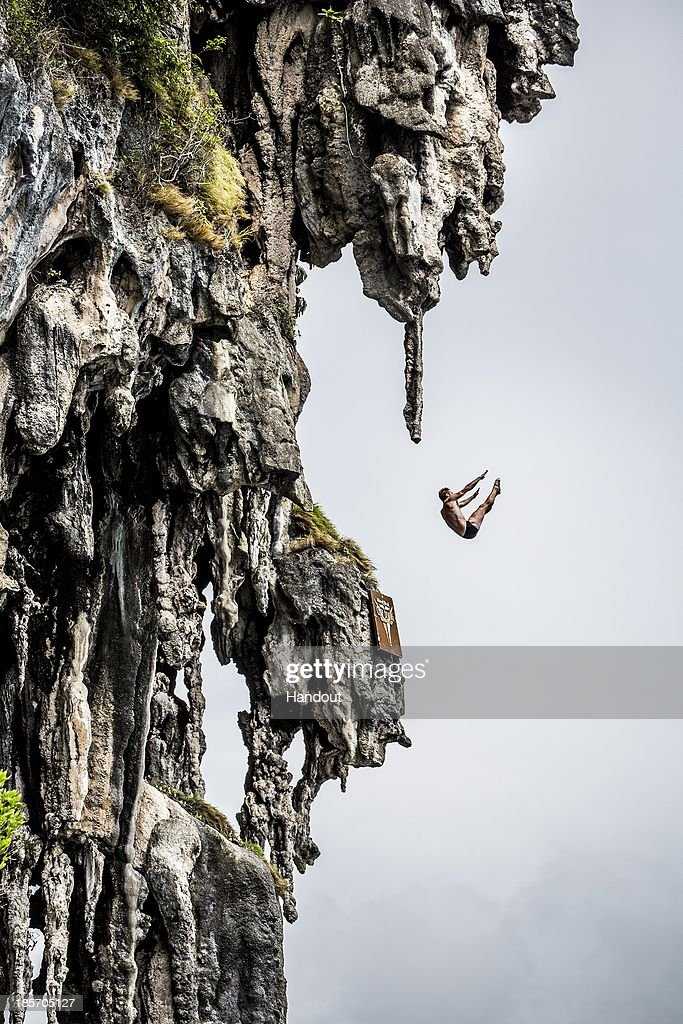 In this handout image provided by Red Bull, Andy Jones of the USA dives from a 25 metre rock at Viking Caves in the Andaman Sea during competition on the fifth day of the final stop of the 2013 Red Bull Cliff Diving World Series on October 24, 2013 at Phi Phi Island, Thailand.