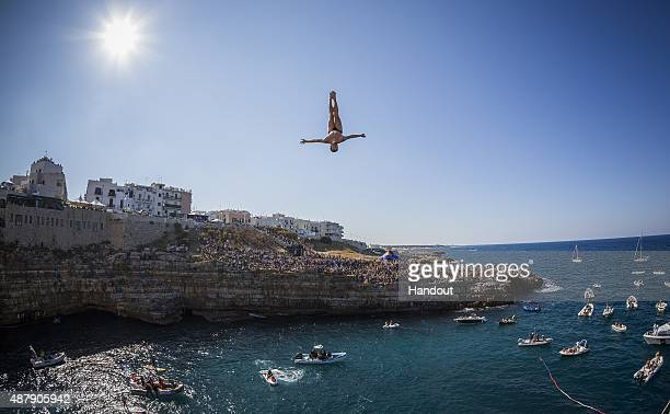 In this handout image provided by Red Bull Andy Jones of the USA dives from the 275 metre platform during the seeding round of the seventh stop of...