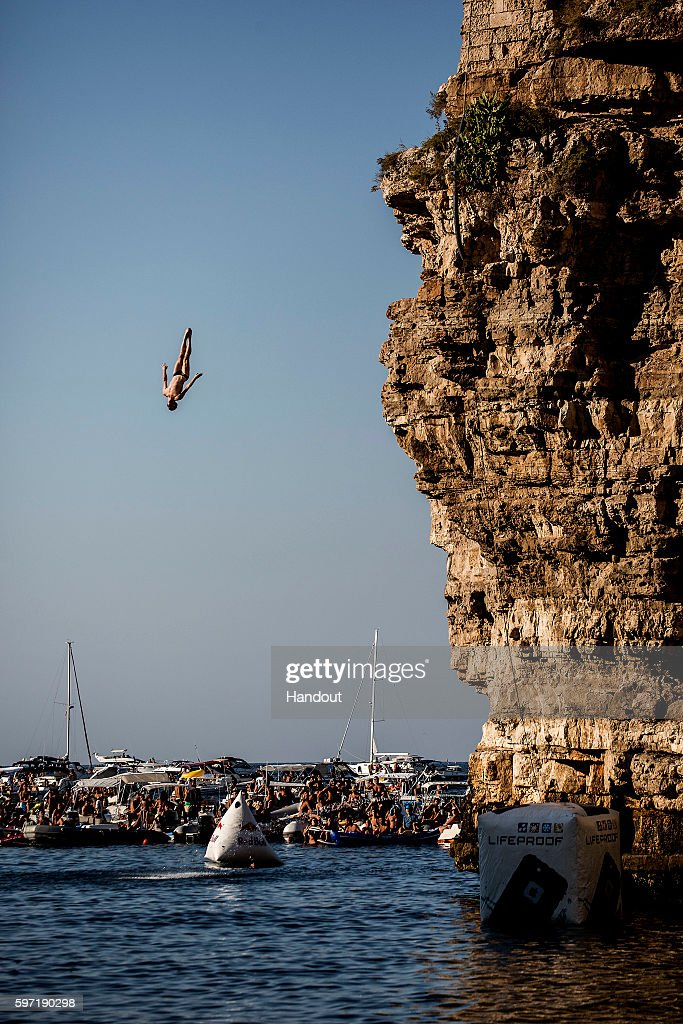 In this handout image provided by Red Bull Andy Jones of the USA dives from the 27 metre platform during the fifth stop of the Red Bull Cliff Diving...