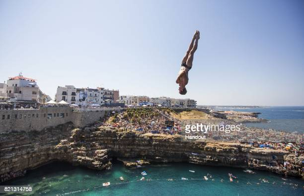 In this handout image provided by Red Bull Andy Jones of the USA dives from the 27 metre platform during the third stop of the Red Bull Cliff Diving...