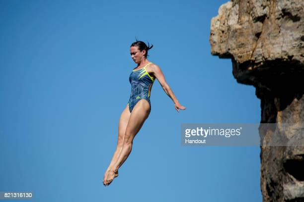 In this handout image provided by Red Bull Anna Bader of Brazil dives from the 21 metre platform during the third stop of the Red Bull Cliff Diving...