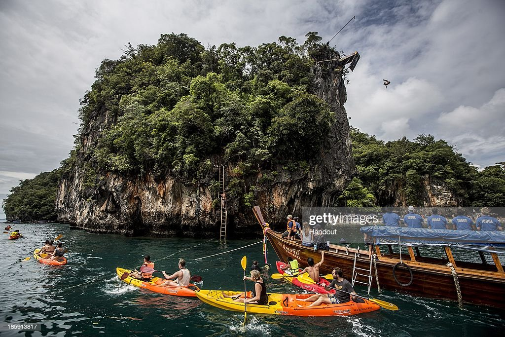 In this handout image provided by Red Bull, Antoliy Shabotenko of the Ukraine dives from the 27 metre platform on Hong Island in the Andaman Sea during the last competition day of the eighth and final stop of the 2013 Red Bull Cliff Diving World Series on October 26, 2013 at Krabi, Thailand.