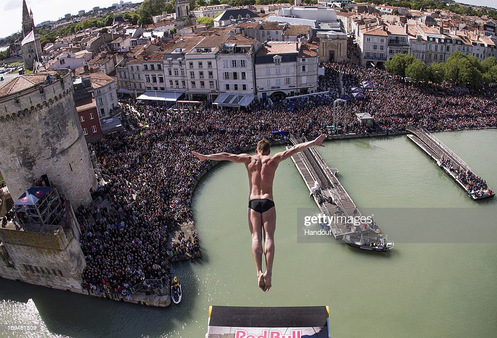 In this handout image provided by Red Bull, Artem Silchenko of Russia dives from the 27.5 metre platform on the Saint Nicolas Tower during the first stop of the Red Bull Cliff Diving World Series on May 25, 2013 at La Rochelle, France.