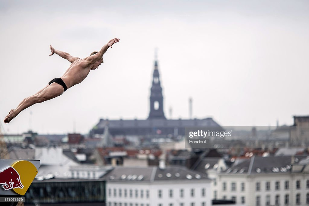 In this handout image provided by Red Bull, Artem Silchenko of Russia dives from the 28-metre platform at the Copenhagen Opera House during the first round of the second stop of the Red Bull Cliff Diving World Series on June 21, 2013 at Copenhagen, Denmark.
