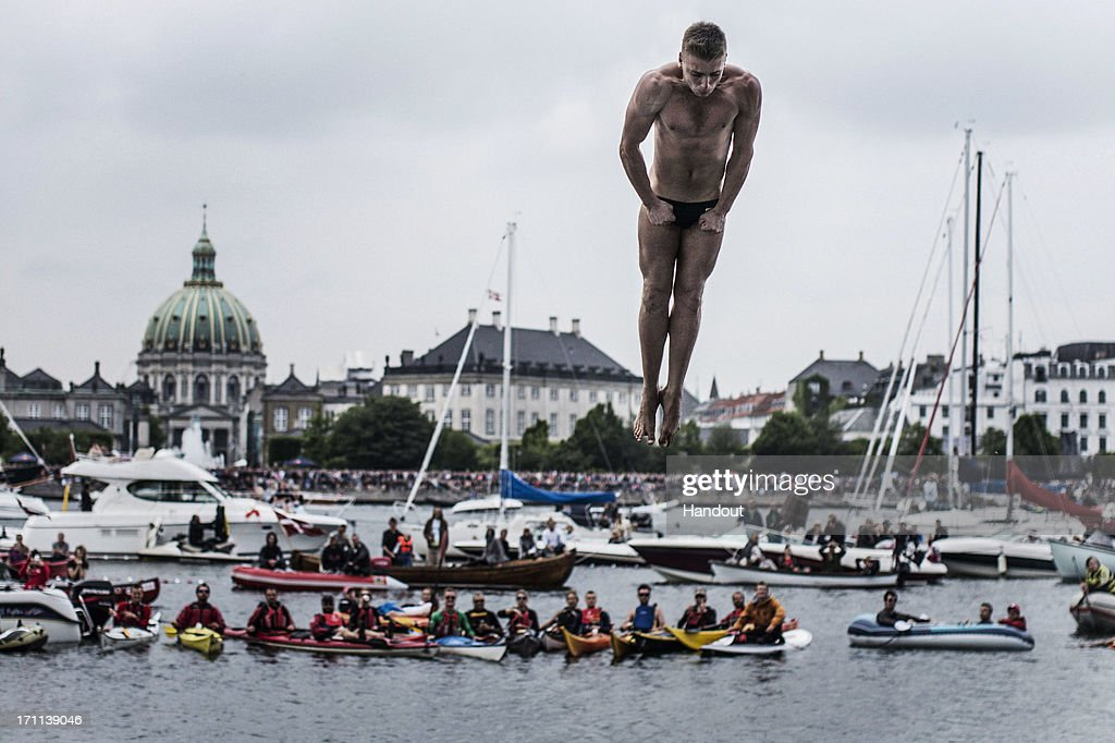 In this handout image provided by Red Bull, Artem Silchenko of Russia prepares for his water entry after diving from the 28 metre platform at the Copenhagen Opera House during the second stop of the Red Bull Cliff Diving World Series on June 22, 2013 at Copenhagen, Denmark.