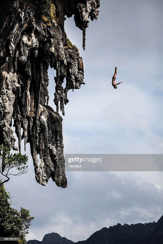 In this handout image provided by Red Bull, Artem Silchenko of Russia dives from a 25 metre rock at Viking Caves in the Andaman Sea during competition on the fifth day of the final stop of the 2013 Red Bull Cliff Diving World Series on October 24, 2013 at Phi Phi Island, Thailand.