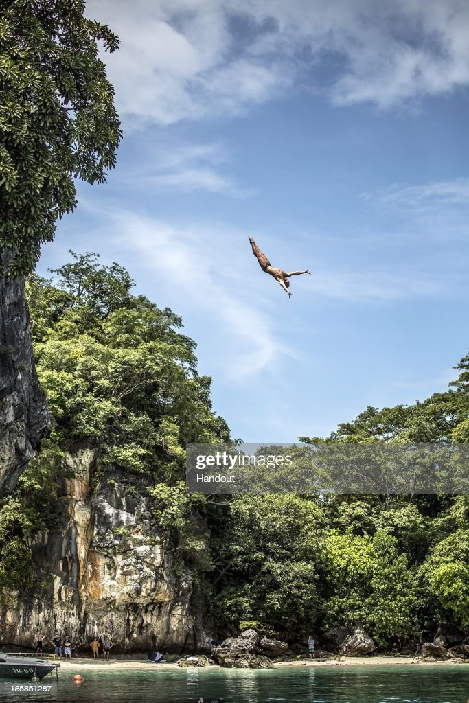 In this handout image provided by Red Bull, Artem Silchenko of Russia dives from the 27 metre platform at training on Hong Island in the Andaman Sea during the final stop of the 2013 Red Bull Cliff Diving World Series on October 25, 2013 at Krabi, Thailand.
